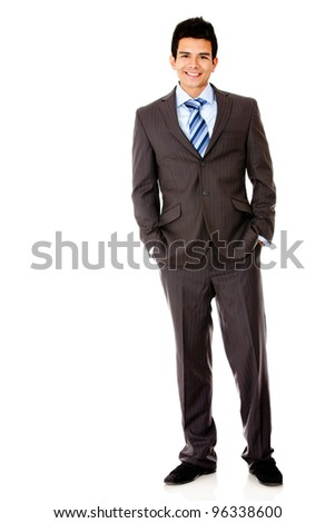 Successful business man standing isolated over a white background
