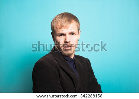 successful business man surprised with a beard and mustache, office style studio photo isolated on a blue backgroundto isolated on a blue background - stock photo