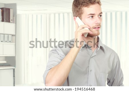 Successful business man talking on the phone in the office - stock photo