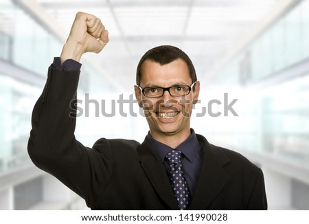 successful business man with open arm winning - stock photo