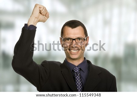 successful business man with open arm winning, at the office - stock photo