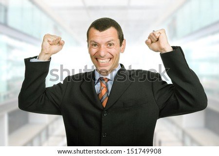 successful business man with open arms at the office - stock photo