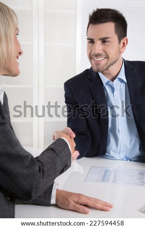 Successful business meeting with handshake: customer and client. - stock photo