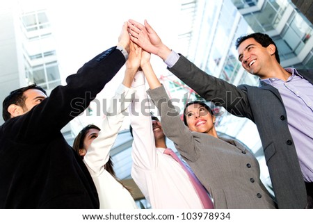 Successful business people celebrating with a high-five - stock photo