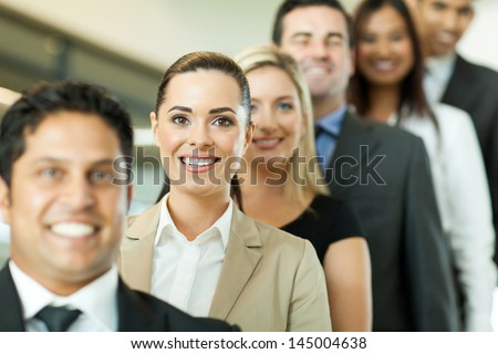 successful business people in a row looking at the camera - stock photo