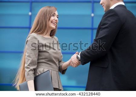 Successful business people shaking hands for greeting or in agreement happy to work together. Focus on smiling businesswoman. Successful Deal Concept. Businesspeople Teamwork - stock photo