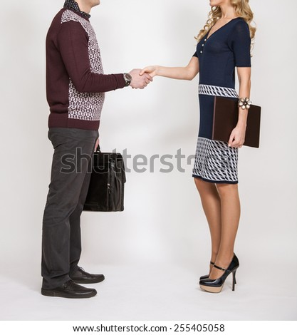 Successful business people shaking hands on white background - stock photo