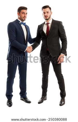 Successful business people shaking hands with confidence as a sign of good cooperation together - stock photo