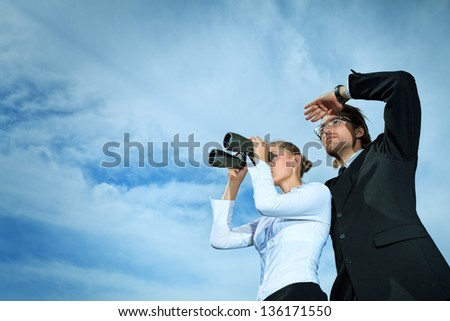 Successful business people  standing over blue sky and purposefully looking away. - stock photo