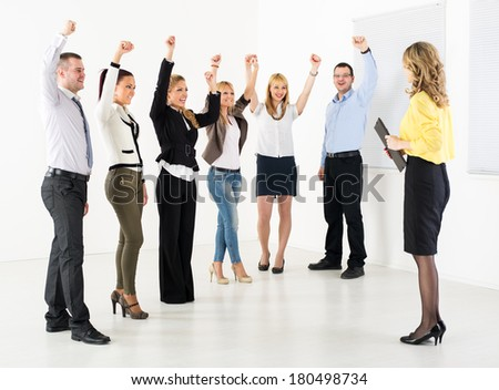 Successful business team congratulates colleague on the exposure.