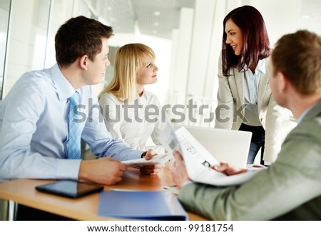 Successful business team holding a meeting to discuss the latest news - stock photo