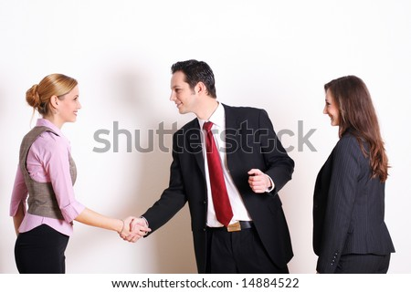 successful business team is saying hello - stock photo