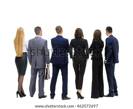 Successful business team looking upwards standing back side