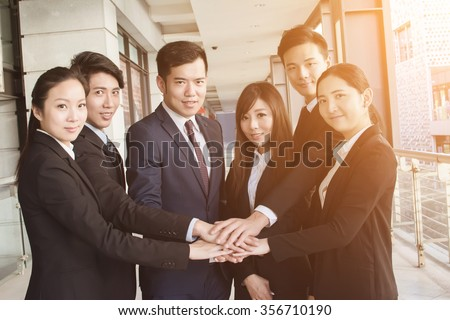 Successful business team of Asian in the city. - stock photo