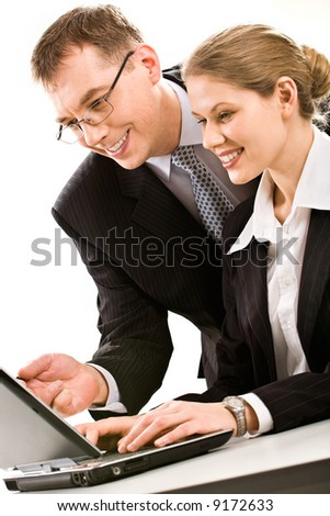 Successful business team of two people working over a laptop - stock photo