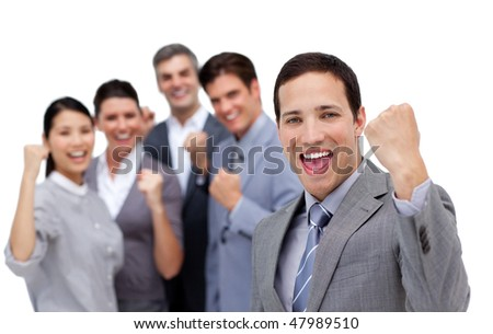 Successful business team punching the air in celebration against a white background - stock photo