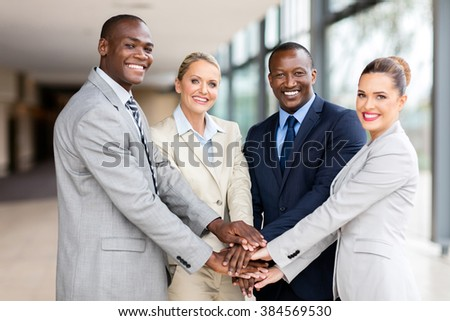 successful business team putting their hands together  - stock photo