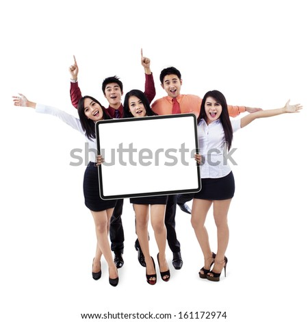 Successful business team showing empty board on white background - stock photo