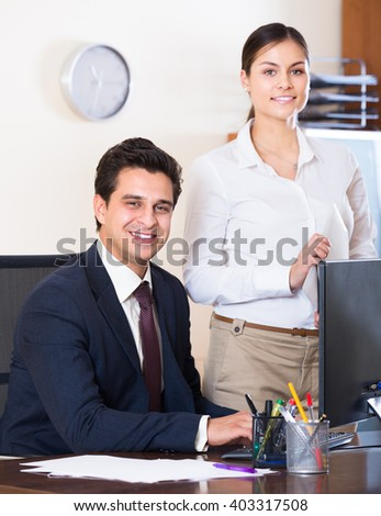 Successful business team smiling and posing in office - stock photo