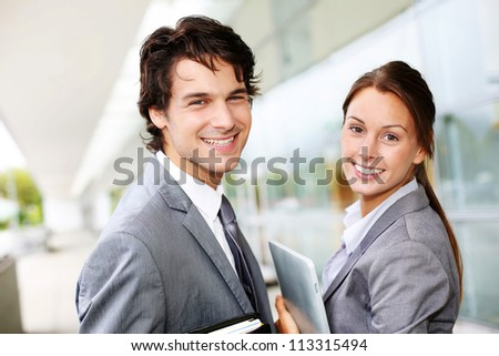 Successful business team standing outside - stock photo