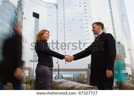 Successful business team striking a bargain (deal). Two business people shaking hands - stock photo