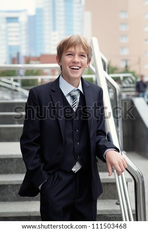 Successful business teen in street setting - stock photo