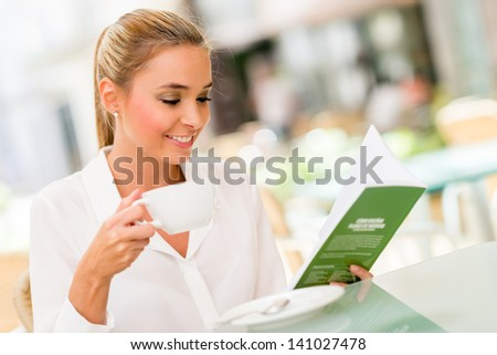 Successful business woman drinking a cup of coffee - stock photo