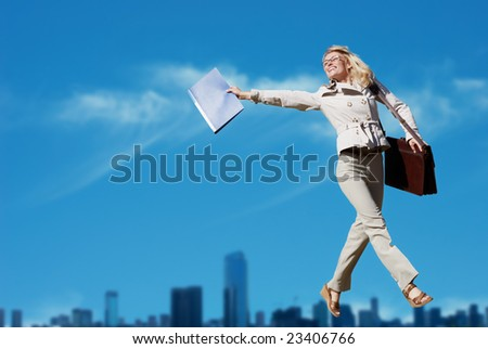 Successful business woman holding document folder and Portfolio - stock photo