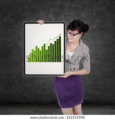 Successful business woman holding growth graph on board - stock photo