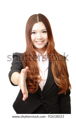 Successful business woman holds out her hand to greet. Isolated over white background, Model is a asian beauty - stock photo