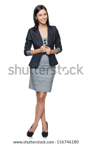 Successful business woman in full length, isolated over white - stock photo