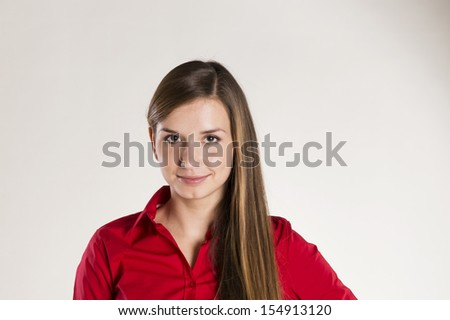 Successful business woman is posing in studio