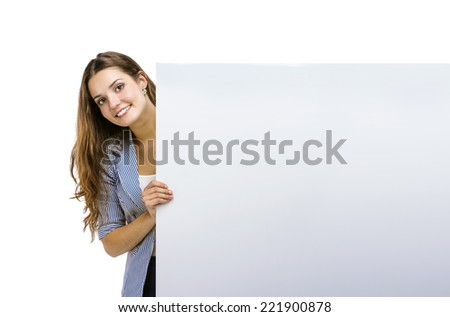 Successful business woman is standing and holding blank banner, isolated background. - stock photo