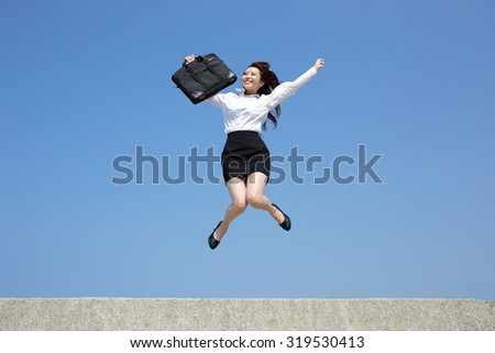 Successful business woman jump and run with blue sky background, full length, asian