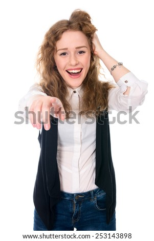 Successful business woman laughs and points at the camera. Isolated on a white background - stock photo
