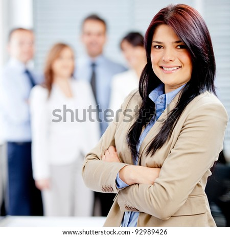 Successful business woman leading a corporate team - stock photo