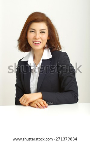 Successful business woman looking confident and smiling - stock photo