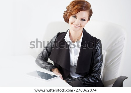 Successful business woman looking confident and smiling, close up - stock photo