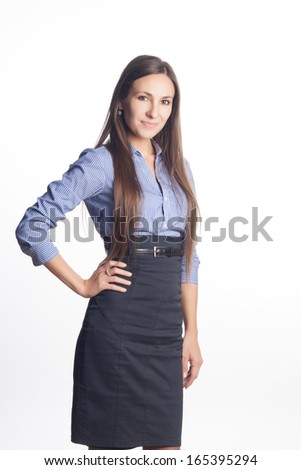 Successful business woman looking confident and smiling isolated on white background.