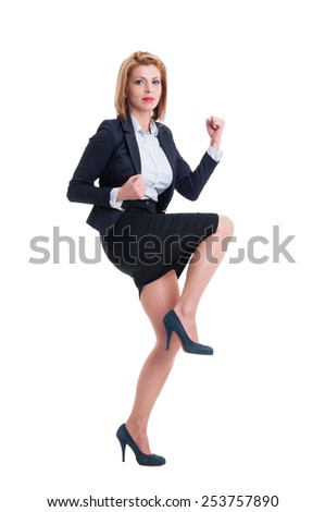 Successful business woman making victory or triumph gesture - stock photo