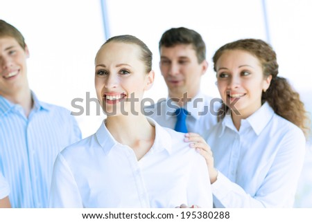 Successful business woman receiving congratulations from his colleagues, business success