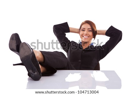 successful business woman resting at her desk on white background