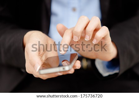 Successful business Woman's hands are using a mobile smart phone.