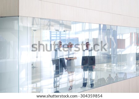 Successful business woman standing with her staff - stock photo