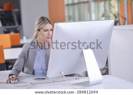 Successful business woman working at the office - stock photo