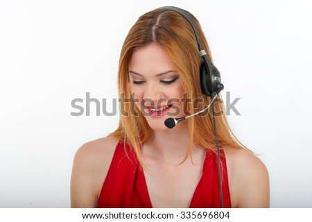 Successful business woman working - she using headphone and computer, happy women - stock photo