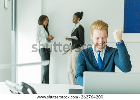 Successful businessman being happy for achieving his goals - stock photo