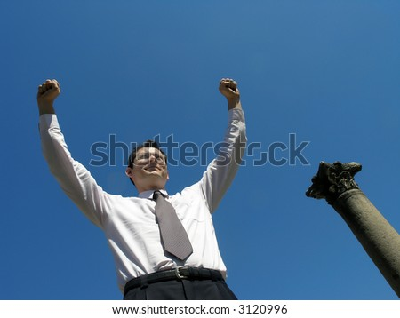 Successful businessman !Businessman with arms up .