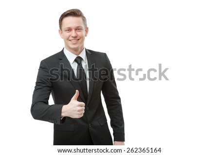 Successful businessman. Cheerful young man in formal wear showing his thumb up and smiling while standing isolated on white background - stock photo