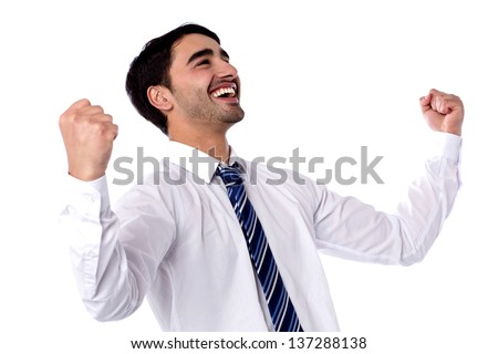 Successful businessman clenching fists in excitement. - stock photo